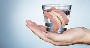 Full dentures in cup of water