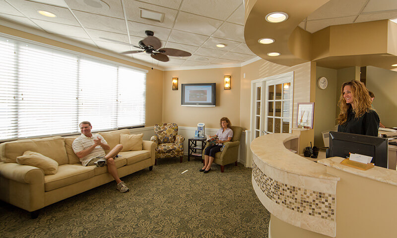 Dental patients relaxing in waiting room