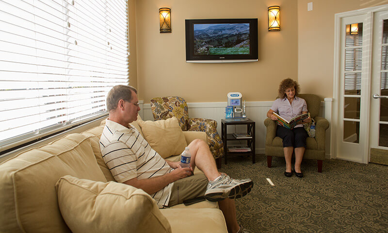 Two dental patients in comfortable waiting area