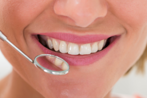 Healthy smile in dental mirror