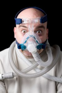 scared man wearing sedation mask
