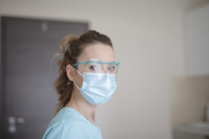 Dental hygienist at dentist in Daytona Beach wearing a mask.